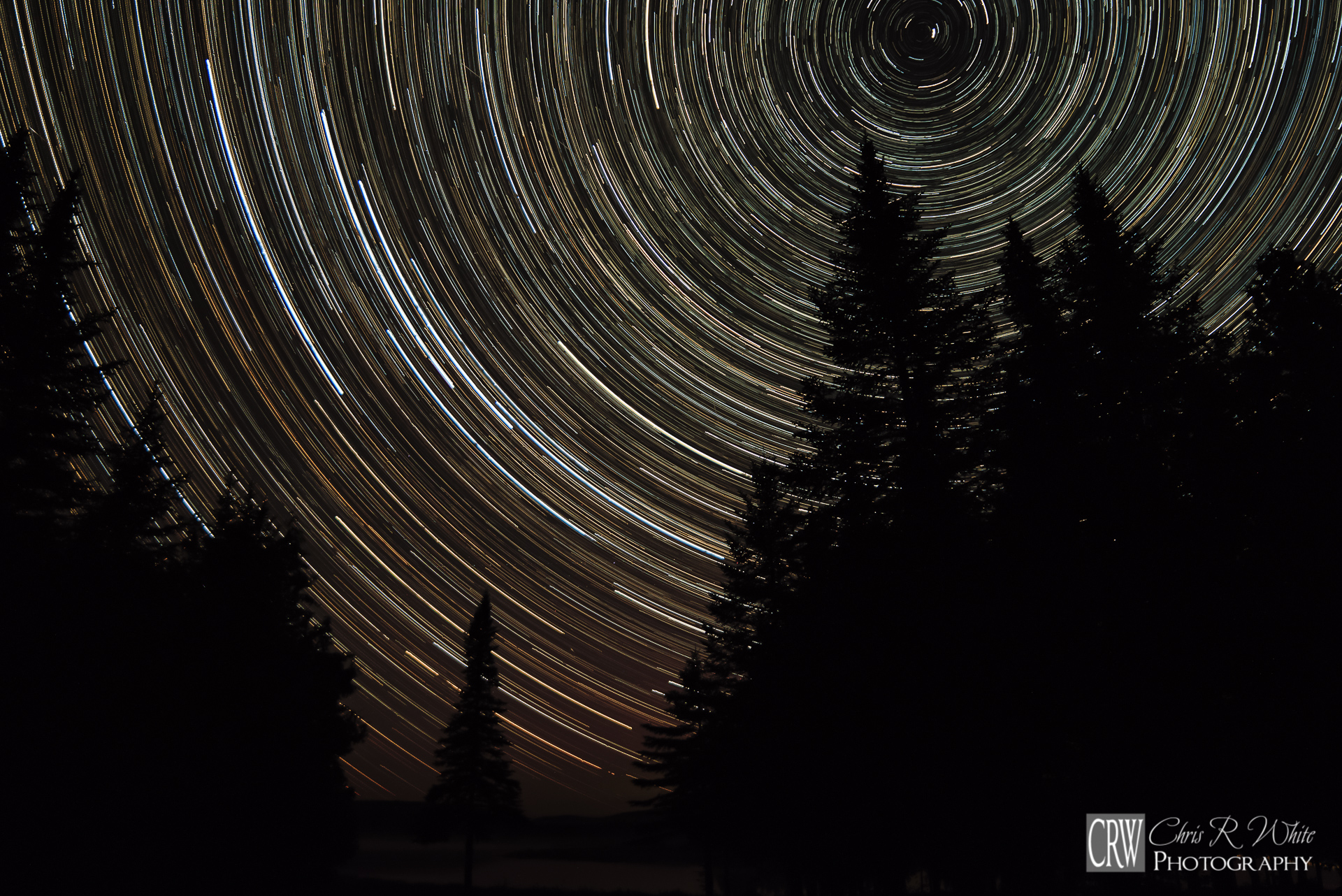 These star trails were created by combining 207 separate exposures of 30 seconds each, chronicling over an hour and half of apparent movement as the Earth rotates.    -Canon 7DII, Rokinon 14mm, f2.8, Combined 30 Second Exposures (207), ISO 1600-